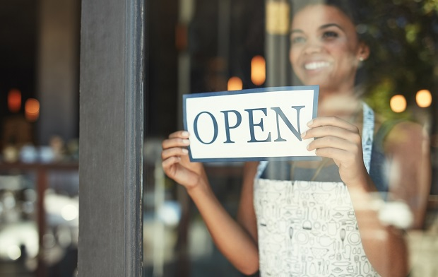 Self Employed owner turning open sign over